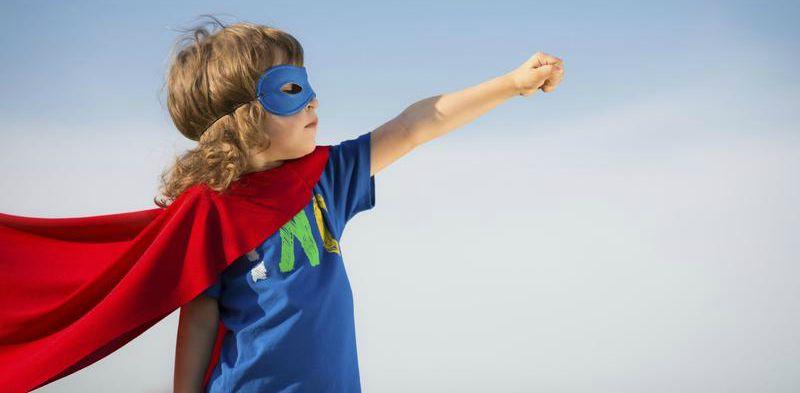 Kid in superhero cape cropped